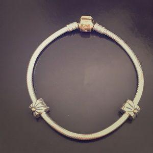 Pandora Two tone bracelet and 2 sunburst Clips